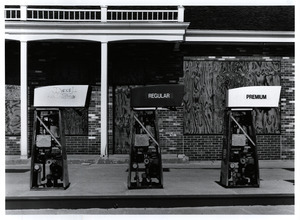Gas pumps at boarded up station