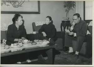 Shirley Graham Du Bois sitting with two unidentified Chinese officials