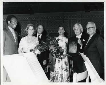 Arthur Fielder with plaque [standing with unidentified people]
