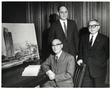 Deputy Mayor Henry Scagnoli (back) with two unidentified men