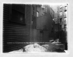 Wooden entensions of buildings nos.63-67 Phillips St. looking westerly in Grove Place