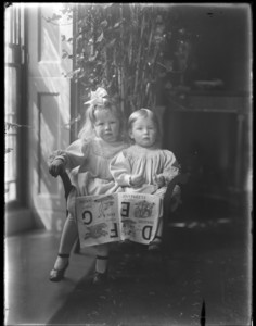Portrait of two children with alphabet book