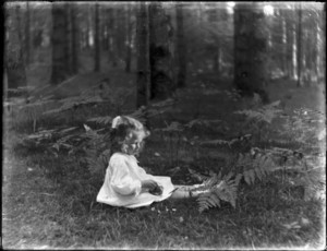 Young girl sitting in woods