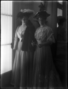 Margaret and Harriot Sumner Curtis standing together