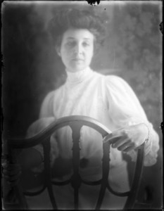Portrait of a woman turned around in her chair
