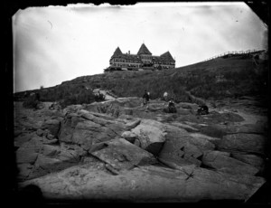 Atlantic House; people on rocks in the foreground.