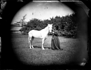 Image of a woman and a horse