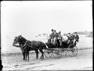 Carriage drawn by two horses on the beach
