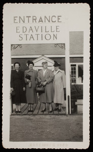 Women standing at the entrance of the Edaville Station (1 of 2)