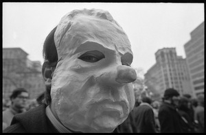 Anti-Vietnam War protester in a paper mache Nixon mask during the Counter-inaugural demonstrations, 1969