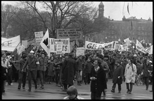 Anti-war protesters marching at the Counter-inaugural demonstrations, 1969, with banners and signs: 'Down with the racist brass,' 'GI's for Peace'