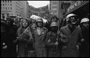 Anti-Vietnam War marchers wearing helmets during the Counter-inaugural demonstrations, 1969