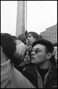 Anti-Vietnam War protesters (close-up) gathered around the flagpole in front of the HEW Building, during the Counter-inaugural demonstrations, 1969