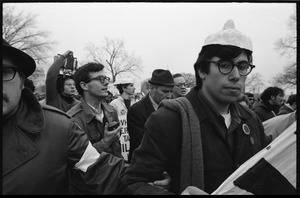 Anti-Vietnam War marchers, one with a Nixon mask on his head, during the Counter-inaugural demonstrations, 1969