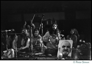 Amazing Grace on stage in the Winterland Ballroom during the Ram Dass 'marathon' with a portrait of Neem Karoli Baba in foreground
