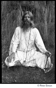 Bhagavan Das: full length portrait seated in a lotus position, facing the camera