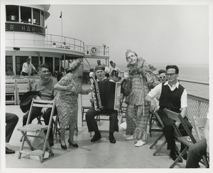 Accordion player and clown on boat ride