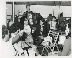 Accordionist and group on boat ride