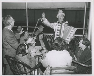 Accordionist playing music on ship