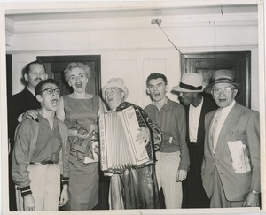 Accordionist and group singing