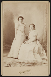 Full-length double portrait of Rhoda and Alice Skillings, facing front, Arlington, Mass., dated December 27, 1897