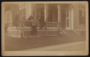Rhoda and Alice Skillings playing tag on the porch of the Elisha Dillingham Bangs House, Central Green, Winchester, Mass., 1889