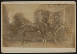 Coach driver and carriage in front of the Elisha Dillingham Bangs House, Central Street, Winchester, Mass., undated