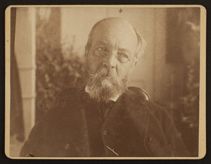 Head-and-shoulders portrait of Frederick Law Olmsted, Sr., seated, facing front, location unknown, ca. 1890