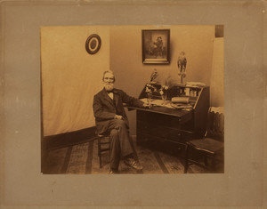 Full-length portrait of Henry Fowler, seated on a chair, facing front, Rae-Putnam Fowler House, Danvers, Mass., undated