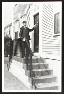 Full-length portrait of William Sumner Appleton, standing, facing three-quarters to the right, 18 Union Street, Nantucket, Mass., 1937