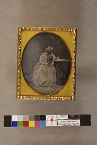 Woman with gloves and open book