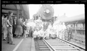 Group of people posing in front of the train at Haverhill Station, Haverhill, Mass.