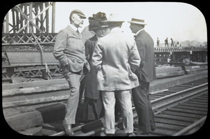 August Belmont, Mrs. Belmont, and two men converse