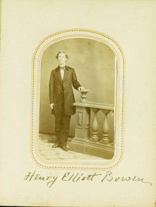 Full-length studio portrait of Henry Elliott Bowen, standing, facing front, holding on to a balustrade, location unknown
