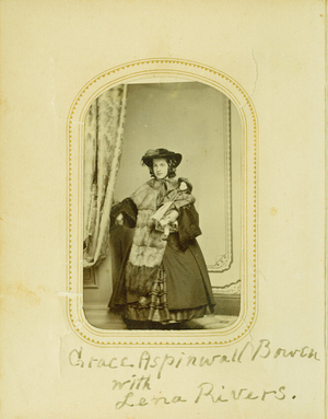 Full-length studio portrait of Grace Aspinwall Bowen, standing, facing front, holding her doll, Lena Rivers, location unknown