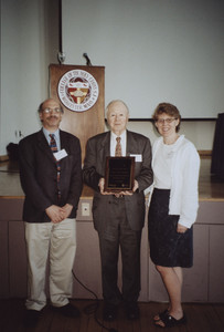 Full-length portrait of Abbott Lowell Cummings, standing, facing front, holding a plaque, Worcester, Mass., June 9, 2008