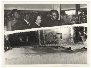 Shirley Graham Du Bois and Kwame Nkrumah look over the open casket at state funeral for W. E. B. Du Bois