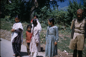 Young girls gather on the street