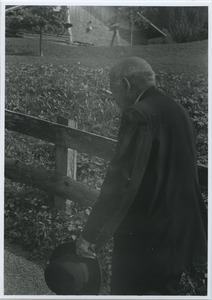 W. E. B. Du Bois walking next to a fence in Switzerland