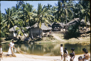 Preparing a fishing net in a Keralan village