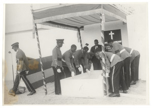 Officers of the Ghanian army lowering casket of W. E. B. Du Bois at his state funeral