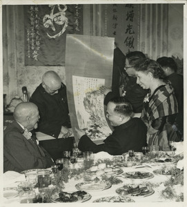 Chinese dignitaries offering a gift to W. E. B. Du Bois