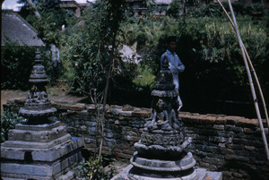Buddhist shrines in walled garden