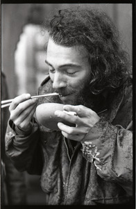 Vietnam Veterans Against the War demonstration 'Search and destroy': veteran eating from a bowl with chopsticks