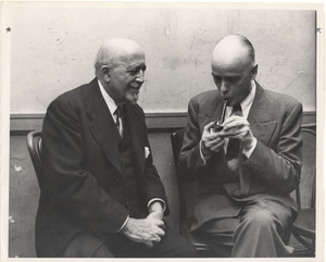 W. E. B. Du Bois seated with unidentified man smoking a pipe