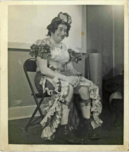 A Seated Performer Poses for a Photograph