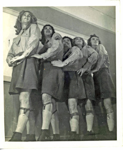 Five Performers Posing in a Line