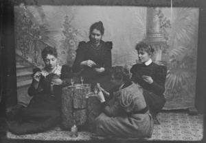 Marie Høeg and Three Unknown People Drinking and Playing Cards