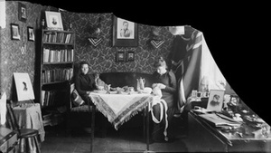 Marie Høeg sits with Tuss and an Unknown Individual at a Table