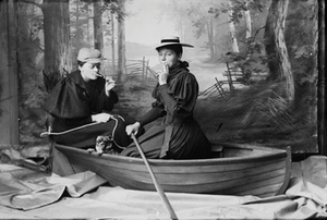 Marie Høeg Sits on a Boat with Tuss and an Unknown Individual
